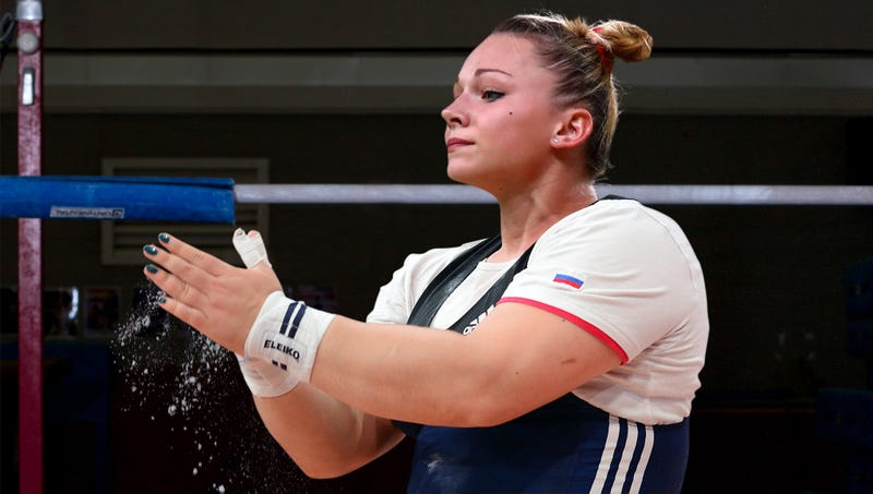 Illustration for article titled Russian Olympic Coach Gently Breaks News To Hulking 200-Pound Gymnast That She Won't Be Competing In South Korea