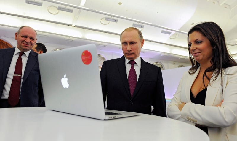 Vladimir Putin and Editor-in-chief of RT (Russia Today) Margarita Simonyan attend an exhibition marking RT's 10th anniversary in Moscow, on December 10, 2015. (Mikhail Klimentyev/Sputnik, Kremlin Pool Photo via AP)