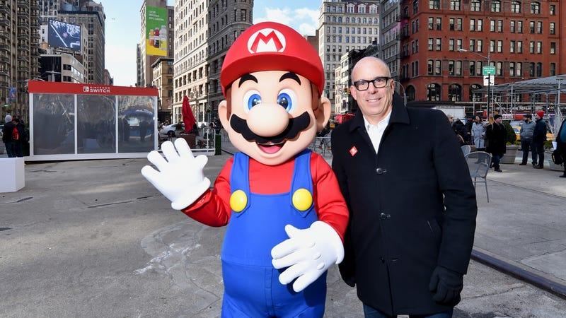 Super Mario posing with the villainous King Koopa