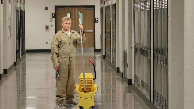 A fifth grader working as a janitor at his school.