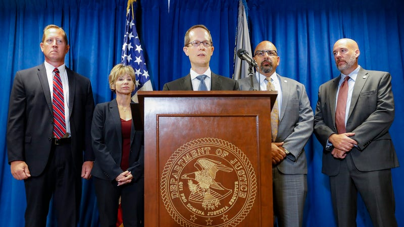 Benjamin Glassman (center), United States Attorney of the Southern District of Ohio, speaks during a news conference on July 18, 2019, in Cincinnati.
