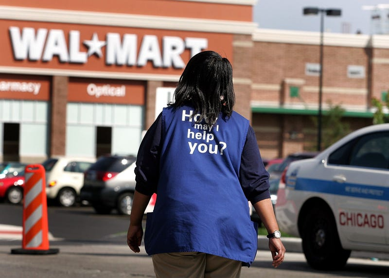 Walmart black americas biggest boss is also its cheap uncle walmart employee anna hines walks through the parking lot of the soon to opened walmart in chicago on sept 21 2006 tim boylegetty images fandeluxe Gallery