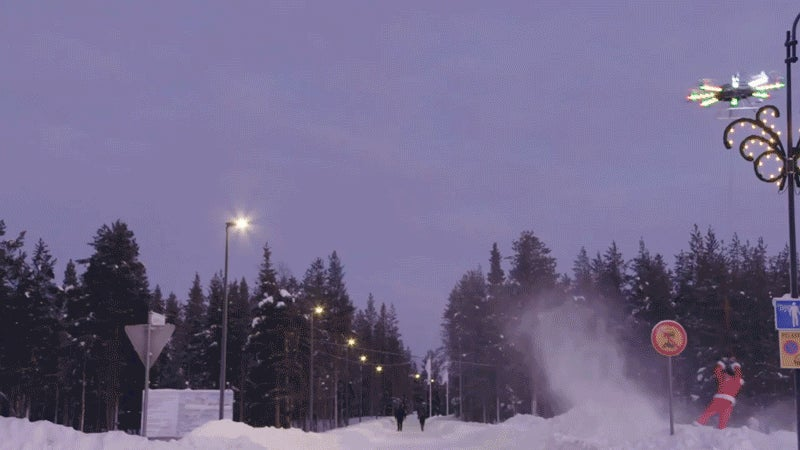 Watch a human-carrying drone lift a snowboarder off a mountain