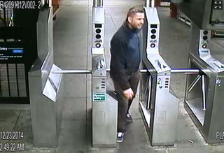 Screenshot of a security video shows off-duty Police Officer Mirjan Lolja exiting the Tremont Ave. subway station in the Bronx, N.Y., on Dec. 23, 2014.New York City Police Department