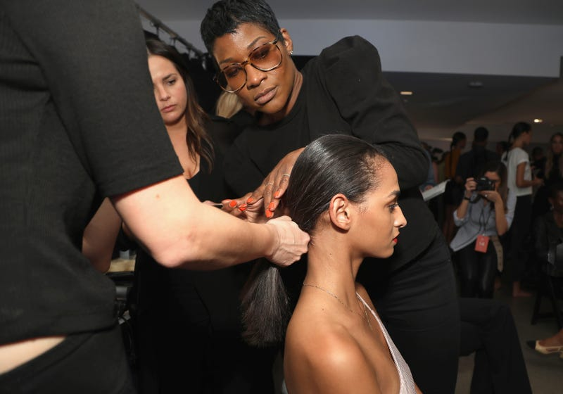 Hairstylist Ursula Stephen prepares models backstage for TRESemme At Cushnie during New York Fashion Week on September 7, 2018 in New York City.