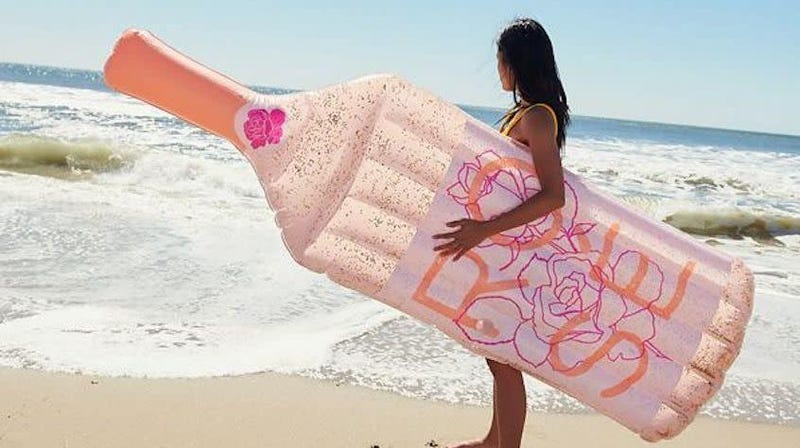 Glitter Rosé Pool Float   $19   Urban Outfitters