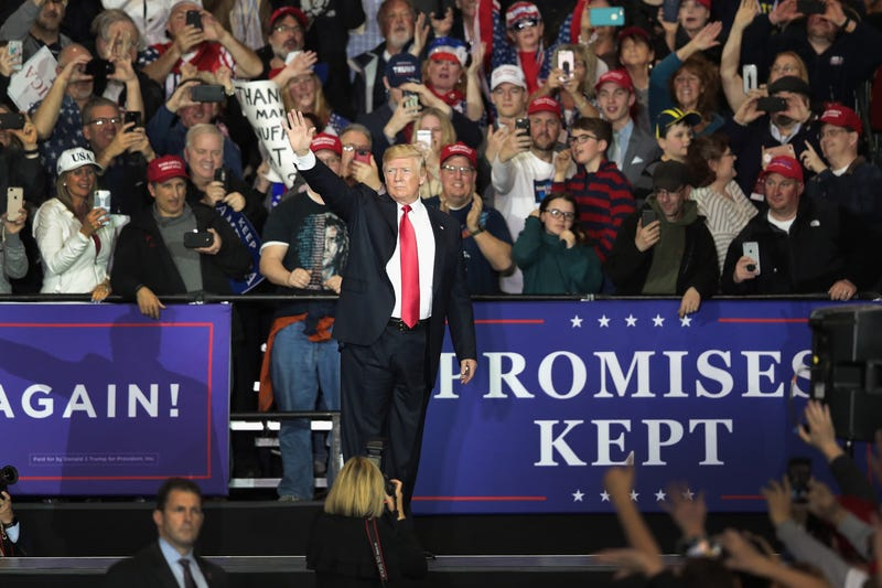President Donald Trump speaks to supporters during a campaign rally on April 28, 2018, in Washington, Mich.
