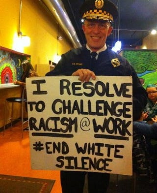 """Pittsburgh Police Chief Cameron McLay is under fire by rank and file officers after he was photographed during the city's New Year's Eve parade holding a sign stating, """"I resolve to challenge racism @ work #EndWhiteSilence.""""@endwhitesilence via Twitter"""