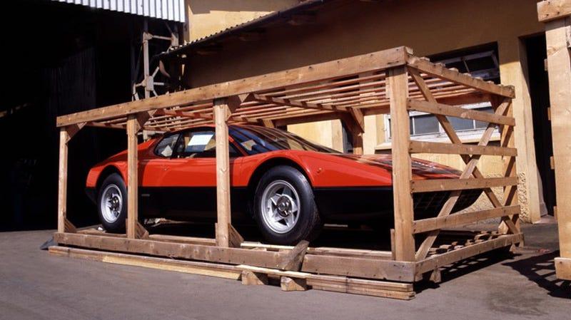 A Ferrari 365 GT4 BB imprisoned in a cruel wooden cage. A car should not be in a cage. A car should be on a road, driving. Photo: Ferrari