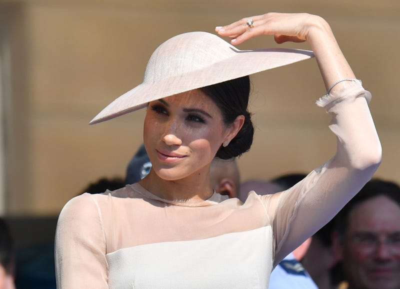 Meghan, Duchess of Sussex, attends the Prince of Wales' 70th birthday celebration at Buckingham Palace on May 22, 2018, in London.