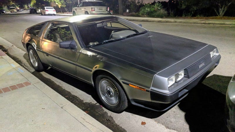 Illustration for article titled DeLorean street parked outside