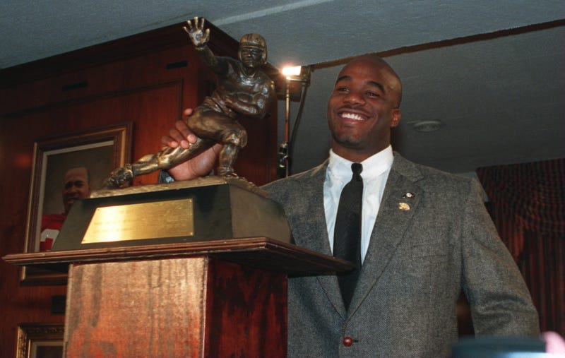 Running back Rashaan Salaam with the Heisman Trophy after being named the 60th winner of the award at the Downtown Athletic Club in New York City on Dec. 10, 1994Jed Jacobsohn/Getty Images