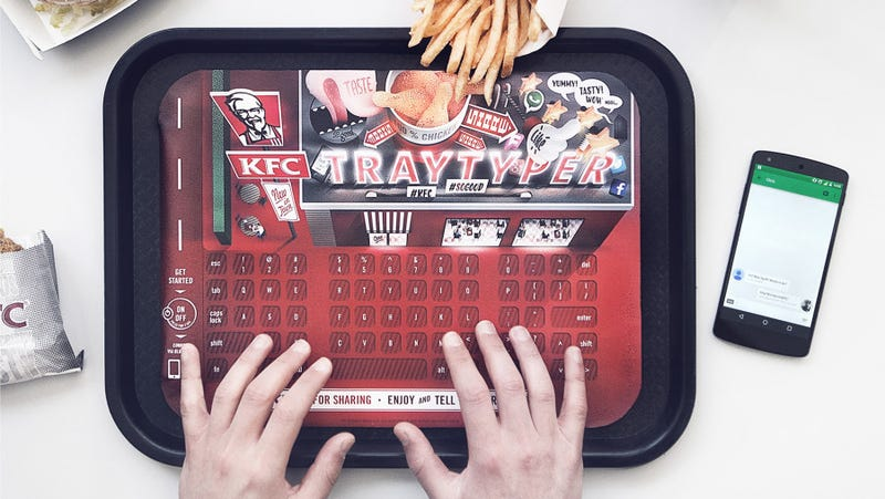 Illustration for article titled KFC Puts Keyboards In Trays So Greasy Chicken Fingers Can Keep Texting
