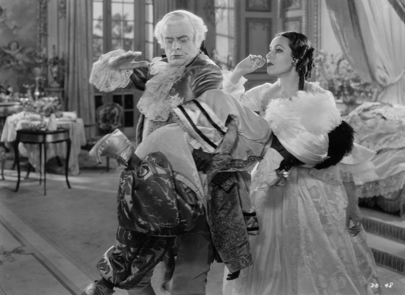 Dolores del Rio (right) as Madame Du Barry watches Reginald Owen spank a black domestic servant in William Dieterle's 1934 film Madame Du Barry. (Hulton Archive/Getty Images)