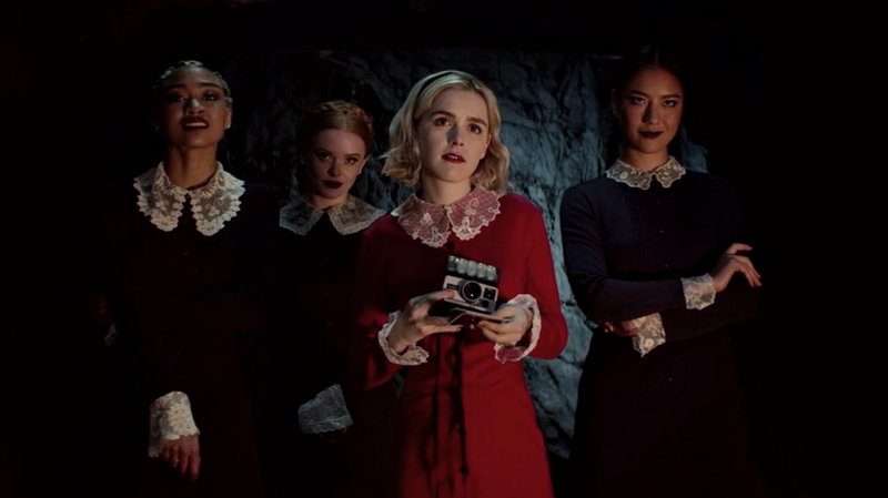 Sabrina (Kiernan Shipka) and the Weird Sisters engage in some bad photography.