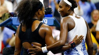 Serena Williams hugs Venus Williams after defeating her during their women's-singles quarterfinals match on day 9 of the 2015 U.S. Open at the USTA Billie Jean King National Tennis Center on Sept. 8, 2015, in New York City. Al Bello/Getty Images