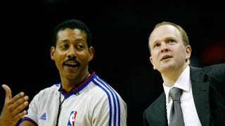 NBA referee Bill Kennedy answers a question from New Jersey Nets coach Lawrence Frank during an Oct. 15, 2007, game in Charlotte, N.C.Kevin C. Cox/Getty Images