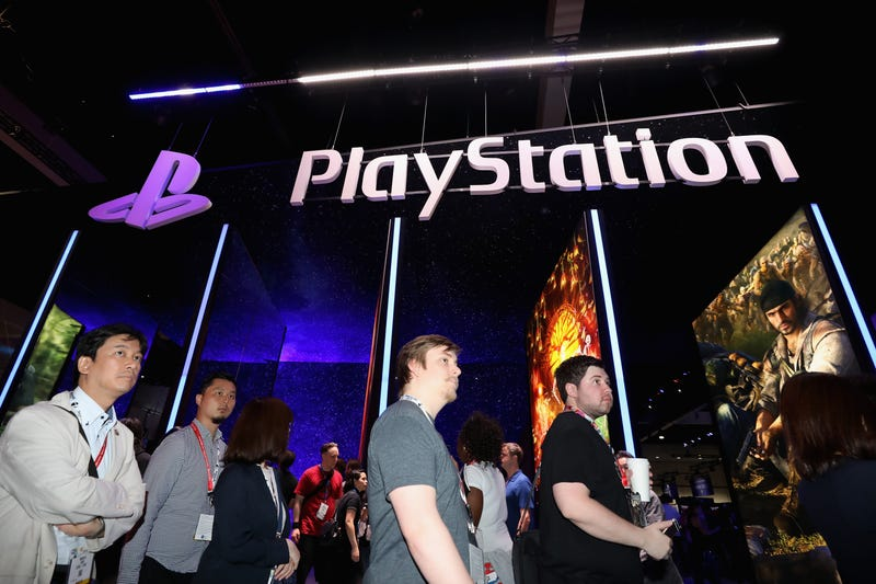 Fans line up at Sony's booth during E3 2018.