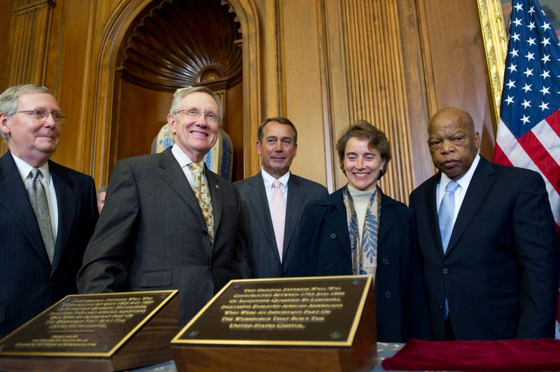 Slave Labor Task Force stands behind newly unveiled plaques.