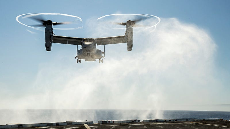 Illustration for article titled USS New Orleans Returns To Port With MV-22 Osprey Hanging Precariously Off Its Deck