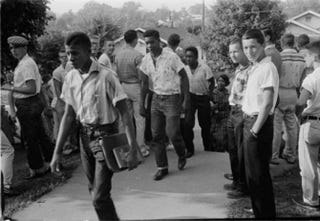 Slate published this photo with the story on Ta-Nehisi Coates' essay on Reparations. The caption read, 'A high school in Clinton, Tenn., in December 1956. Reparations wouldn't just be about America's slaveholding era.'Thomas J. O'Halloran/Library of Congress
