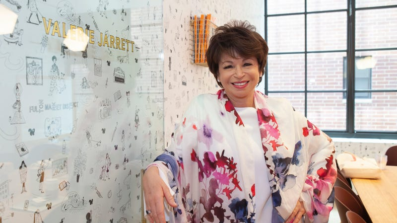 Valerie Jarrett poses in front of the conference room that bears her name at the Chicago satellite of The Wing.
