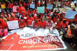 Members of civil society groups sit to protest the abduction of Chibok schoolgirls during a rally pressing for the girls' release in Abuja, Nigeria, May 6, 2014.PIUS UTOMI EKPEI/AFP/Getty Images