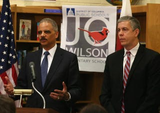 Attorney General Eric Holder (left) and Education Secretary Arne Duncan during a visit to J.O. Wilson Elementary School in Washington, DCMark Wilson/Getty Images