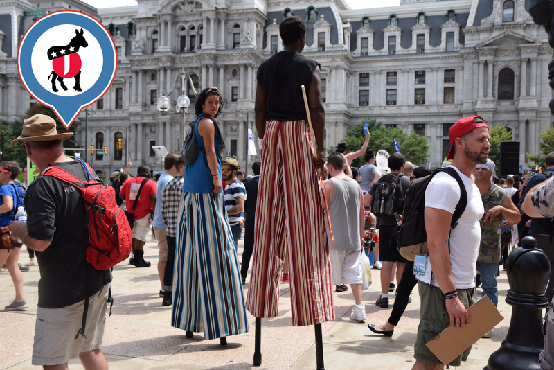 """Student artists on stilts at a """"Bernie or Bust"""" rally in Philadelphia. (Photo by Ellie Shechet)"""