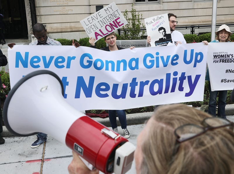 Proponents of net neutrality protest against Federal Communication Commission Chairman Ajit Pai outside the American Enterprise Institute. (Chip Somodevilla/Getty Images)