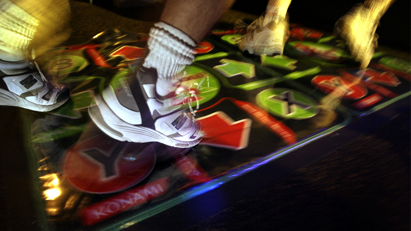 I don't know why io9's Getty subscription included this blurry 2004 shot of people's feet on a Dance Dance Revolution cabinet, but I'm very glad it did.