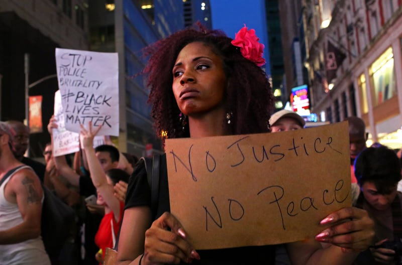 Activists protest in New York City's Times Square on July 7, 2016, in response to the recent fatal shootings of two black men by police.  Protests and public outcry have grown in the days following the deaths of Alton Sterling on July 5, 2016, in Baton Rouge, La., and Philando Castile on July 6, 2016, in Falcon Heights, Minn.Yana Paskova/Getty Images