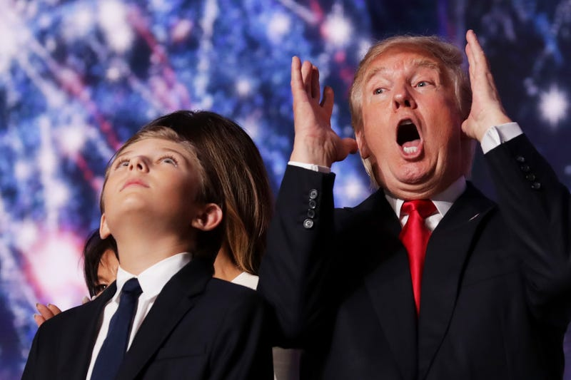 Donald Trump reacts as his son Barron Trump looks on at the end of the Republican National Convention on July 21, 2016, at the Quicken Loans Arena in Cleveland.