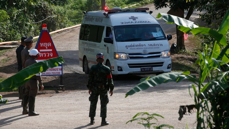 Earlier today, an ambulance with flashing lights leaves the cave rescue area in Mae Sai, Chiang Rai province, northern Thailand.