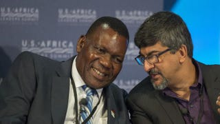 George Chaponda, Malawi's minister of foreign affairs and international cooperation, speaks with Rakesh Rajani, Tanzania's civil society leader, during the Civil Society Forum Aug. 4, 2014, at the US-Africa Leaders Summit in Washington, D.C.JIM WATSON/AFP/Getty Images