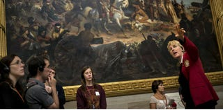 Tourists listen to a tour guide speak in the Rotunda of the U.S. Capitol on Oct. 17. (Brendan Smialowski/AFP/Getty Images)