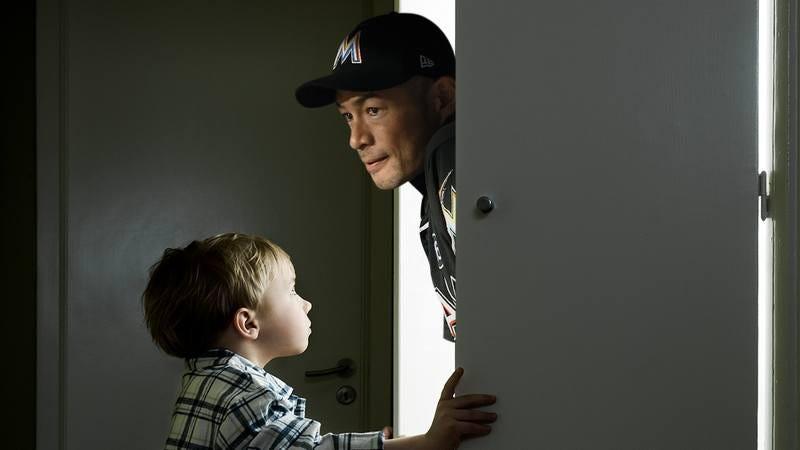 A young boy next to Ichiro.