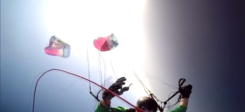 Illustration for article titled Tandem Paragliding Parachute Rips In Half During Stunt