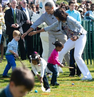 President Barack Obama and first lady Michelle Obama cheer on children taking part in an egg-rolling race as part of the White House Easter Egg Roll on the South Lawn of the White House April 1, 2013.SAUL LOEB/AFP/Getty Images