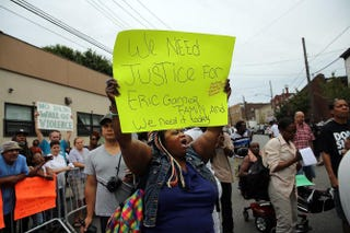 Protesters demonstrate on July 19, 2014, against the death of Eric Garner during an attempted arrest in the Staten Island borough of New York City.Spencer Platt/Getty Images