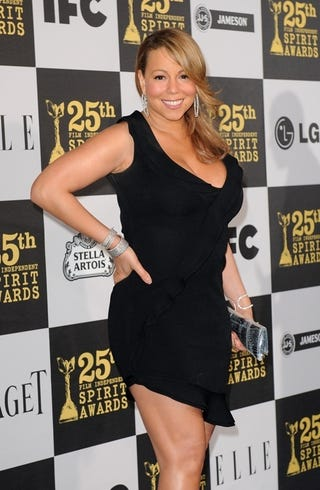 Illustration for article titled Mariah Sparks Pregnancy Rumors, Sandra Accepts Her Razzie Awards, And Oscar Gossip Galore