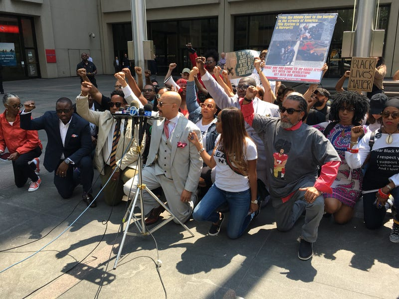 Protesters kneeling in support of players impacted by the NFL's new national anthem rule in front of the NFL's headquarters in New York City on May 25, 2018.