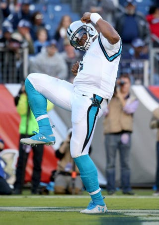 Cam Newton of the Carolina Panthers celebrates Nov. 15, 2015, after scoring a touchdown during the second half of the game against the Tennessee Titans in Nashville, Tenn.Andy Lyons/Getty Images