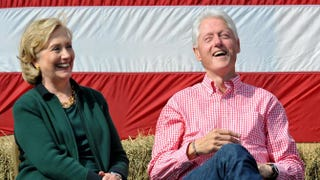 Former Secretary of State Hillary Clinton and President Bill Clinton laugh during a speech by U.S. Sen. Tom Harkin (D-Iowa) at the 37th Harkin Steak Fry Sept. 14, 2014, in Indianola, Iowa.Steve Pope/Getty Images