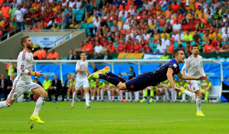Illustration for article titled The Best Photos Of Robin Van Persie's Amazing Flying Header Goal