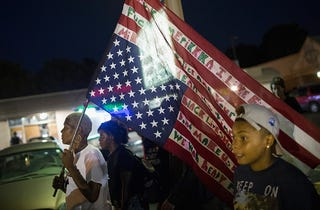 Demonstrators, marking the one-year anniversary of the shooting of Michael Brown, protest along West Florissant Street in Ferguson, Mo., on Aug. 10, 2015.Scott Olson/Getty Images