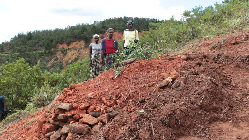 This family lost a relative to Cyclone Idai. Here they stand next to the grave in Chimanimani, Zimbabwe.