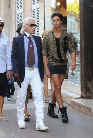 """Illustration for article titled Karl Lagerfeld Strolls The Streets With His """"Muse"""""""