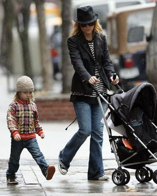 Illustration for article titled Kate Hudson, Son, Stomp In Sidewalk Puddles