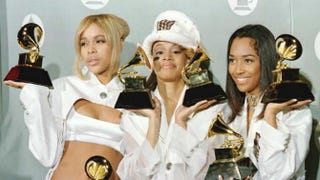 The original members of TLC hold some of the awards they won during the 38th Annual Grammy Awards in 1994 in Los Angeles.JEFF HAYNES/AFP/Getty Images
